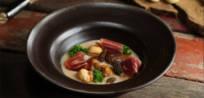 Soupe aux Châtaignes, Champignons d'Hiver, Chou Frisé Kale et Jambon <i>Ibérico</i> Cinco Jotas